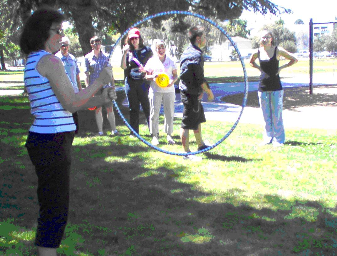 SASC Benita MacDonald holds a hula hoop for the Frisbee throw.
