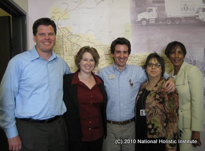 Melanie Burns & Joe Bob Smith (2nd & 3rd from left) join the Food Bank's Michael Flood, Flori Schutzer & Jeanna Kindle.