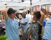 AMTA volunteers educating consumers on the benefits of massage at Times Square Summer Fest.