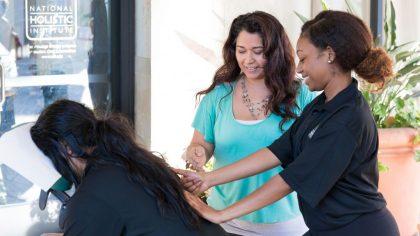 April Villareal teaching Chair Massage techniques